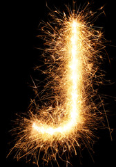 Sparkler firework light alphabet J isolated on black