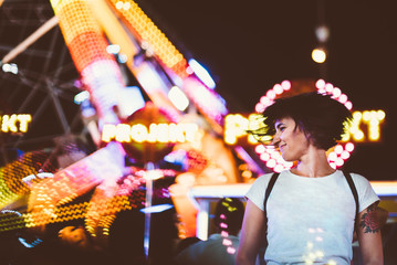 Excited model posing in illuminated night park