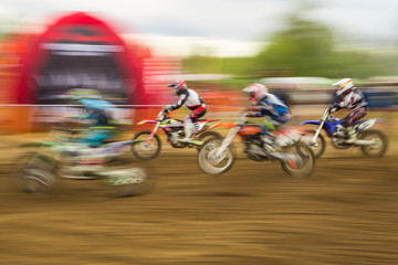 Motocross competition bike rider in motion