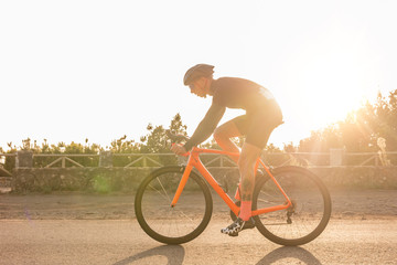 Man riding a bicycle on the mountain road
