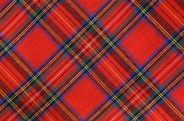 fabric with red and blue Tartan-type Scottish designs and yellow