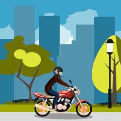 Motorcyclist racing on bike in city