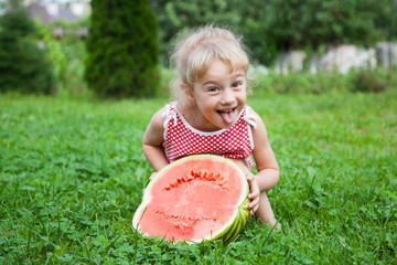 Funny little girl with watermelon slice