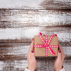 Present. Gift box. Woman holding small gift box with ribbon.