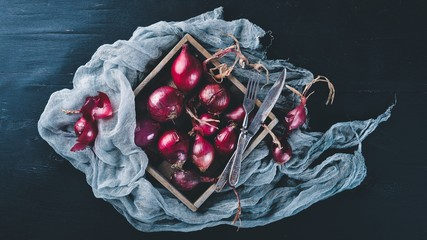 Ripe onion. On a wooden background. Top view. Free space for your text.
