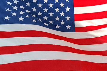Waving star and stripes American flag on white background