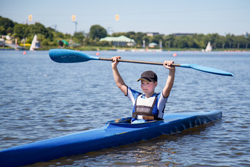 The winner. A boy in a row club in Poland. Hard work on a sport form in rowing and canoeing. Athletic teenager.
