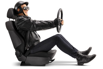Biker sitting in a car seat and holding a steering wheel