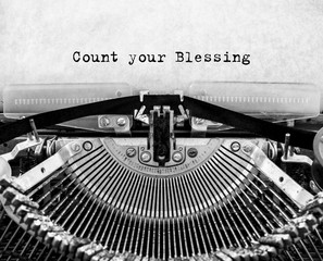 Vintage typewriter with text Count your Blessing.