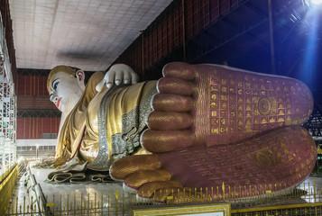 big buddha Kyauk Htat Gyi  reclining buddha statue in Myanmar (Burma) at night  selective focus detail of foot