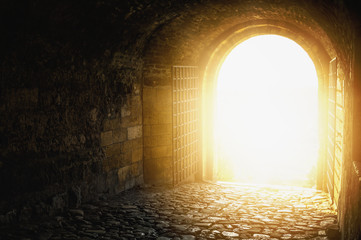 Door to Heaven. Arched passage open to heaven`s sky. Light at end of the tunnel.