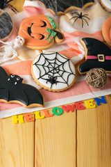 Attributes to the holiday, the inscription Halloween, on wooden table