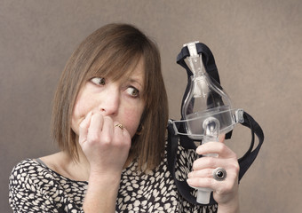 Woman thinks about using a CPAP mask