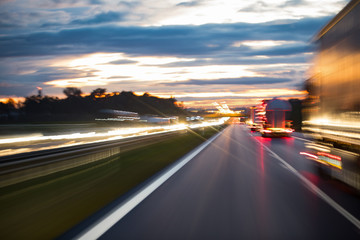 Fotomurales - City evening lights, highway zoomed perspective blurred by high speed of the car.