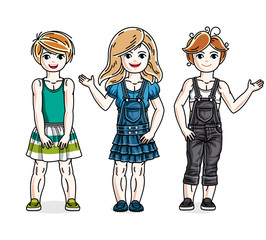 Different cute little girls standing in stylish casual clothes. Vector set of beautiful kids illustrations.