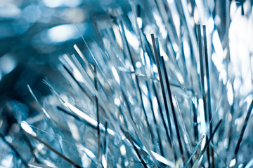 Holiday background of blue tinsel macro