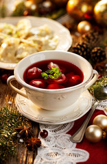 Christmas beetroot soup, borsch with small dumplings with mushrooms stuffing, traditional Christmas eve dish in Poland