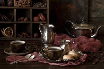 Coffee, chocolate and sweets. Still life in vintage style.
