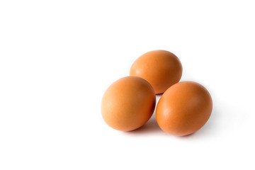 Chicken eggs brown close-up on white background isolate