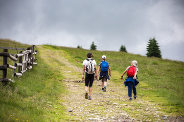 Walking tour through the romanian countryside, mountains, villages, waters. Holidays in carpathian nature.