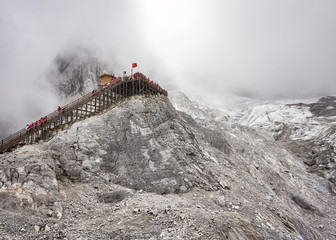 Viewing platform at the Jade Dragon Snow Mountain in clouds, China.