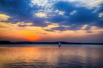 Sailboat sunset fantasy sailing along its journey.