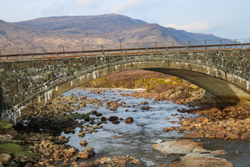 Stone Bridge over Creek on Isle of Skye Scotland UK