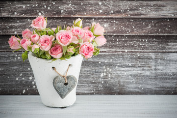 Pink roses in concrete pot