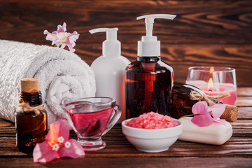 Spa essentials including natural oils, salt, soap and candle. Organic cosmetics concept