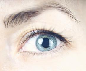 female blue eye close up
