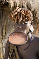Mursi woman with clay lip plate, Mursi Hills, Mago National Park, Lower Omo Valley, Ethiopia, Africa.
