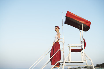 Pin Up standing on lifeguard chair