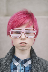 Young girl with short pink hair and party glasses