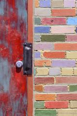 Door and Colored Brick Wall