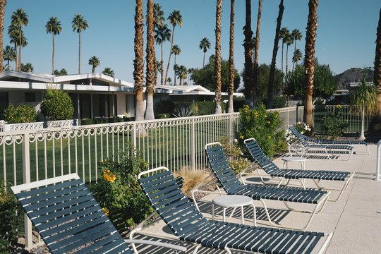 Chairs around an outdoor pool in Palm Springs
