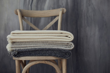 Set of wool blankets on a wooden chair