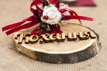 Wooden love word with ladybug for wedding