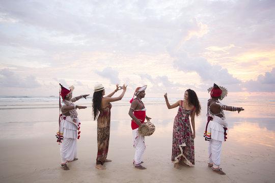 Kandyan Dancers with female tourists. Sri Lanka.