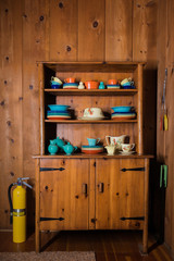 Set of Colorful, Antique Dishes in a Cabin
