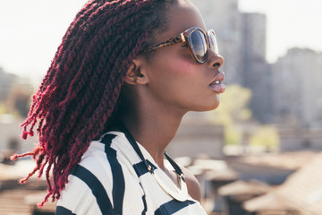 African Woman With Sunglasses and Pink Dreadlocks