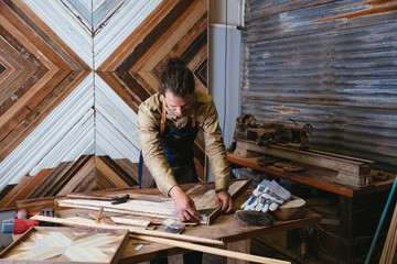 Man working on his art in workshop studio