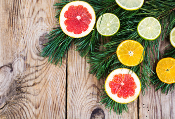 Abstract Christmas tree food background with grapefruit, mandarin, lemon, lime, kumquat