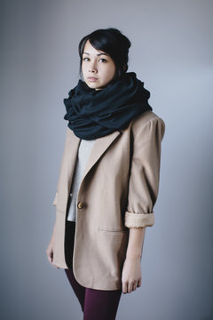 A portrait of an asian girl in a big scarf