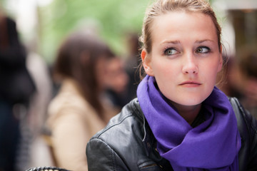 Young woman sitting in a street cafe in paris