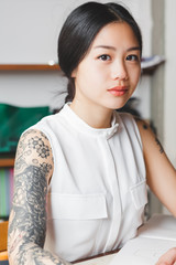 Portrait of a Young Female Student with Tattoos