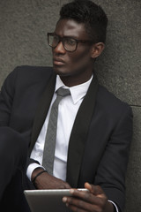 Portrait of african young businessman with digital tablet