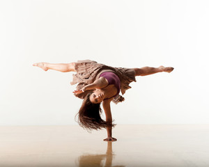 Strong and flexible woman dancing