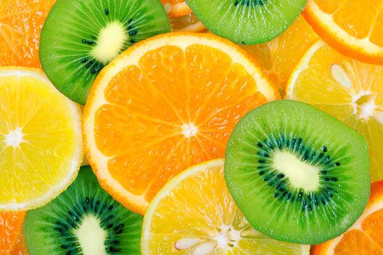 Fruit slices background (lemon, kiwi, orange, tangerine)