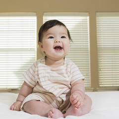 Laughing baby girl portrait