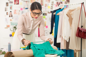 Tailor Tape Measuring a Dress
